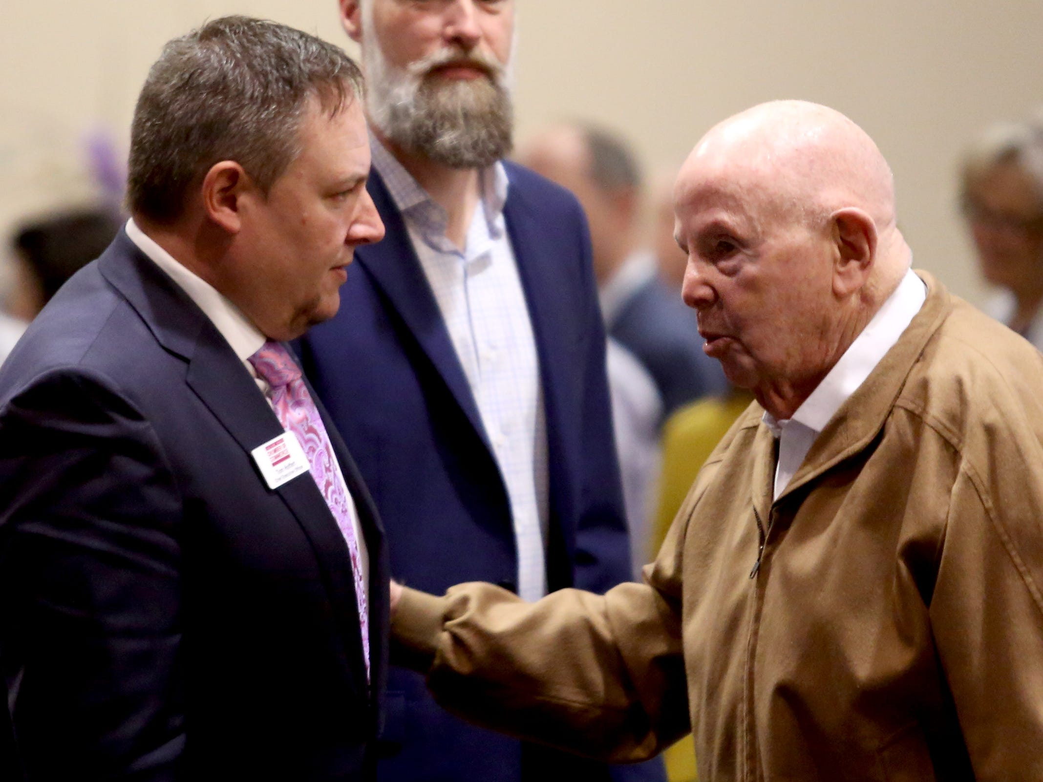 Tom Hoffert, left, the chief executive officer of the Salem Area Chamber of Commerce, welcomes Gerry Frank to the monthly Forum Speaker Series at the Salem Convention Center on May 13, 2019.