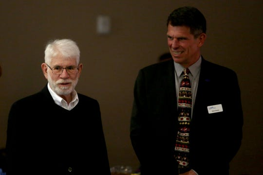 Mayor Chuck Bennett, left, and Salem City Manager Steve Powers attend the Salem Area Chamber of Commerce monthly Forum Speaker Series at the Salem Convention Center on May 13, 2019.