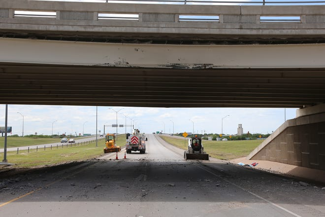 The aftermath of the collision at the Bell Street overpass after a truck carrying windmill parts struck it on Sunday, May 12, 2019.
