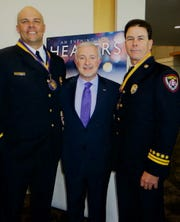 """""""Healers"""" Captain/Paramedic Blair Bockhaus and District Chief Scott Gurganus, both with Bossier City Fire Department,  flank LSU Health Shreveport Chancellor Dr. G.E. Ghali,at """"Healers."""""""