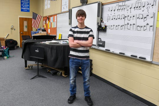Ty Kulm stands at the front of the choir room, his favorite place, on Monday, May 13, 2019 at Washington High School in Sioux Falls. He plans to attend South Dakota State University to major in electrical engineering with a minor in music. He's one in the first set of quadruplets to graduate from the Sioux Falls School District.