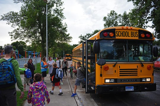 Children get off of a bus at the new Sonia Sotomayor Elementary School in Sioux Falls in this file photo. While Sioux Falls maintains the traditional five-day school week, 23 percent of schools in the state are have a four-day school week.