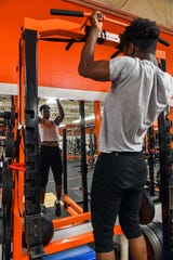 Washington linebacker and Nebraska recruit Randolph Kpai works out in the Warriors weight room last spring. Athletes have had to find other ways to work out due to social distancing guidelines.