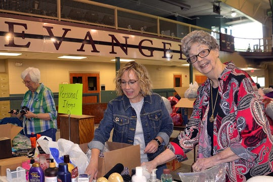 Jill Pace and Marjorie Compton (right) sort a box of items, while Margaret's life-long friend Jean Risner prepares donated jewelry for the annual Evangel University Auxiliary sale, May 15-18.