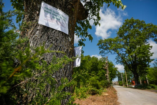 The Christian County special highway commission for Ozark began felling trees on River Bluff Drive in order to widen the road. Residents repeatedly urged the commission to halt the project.