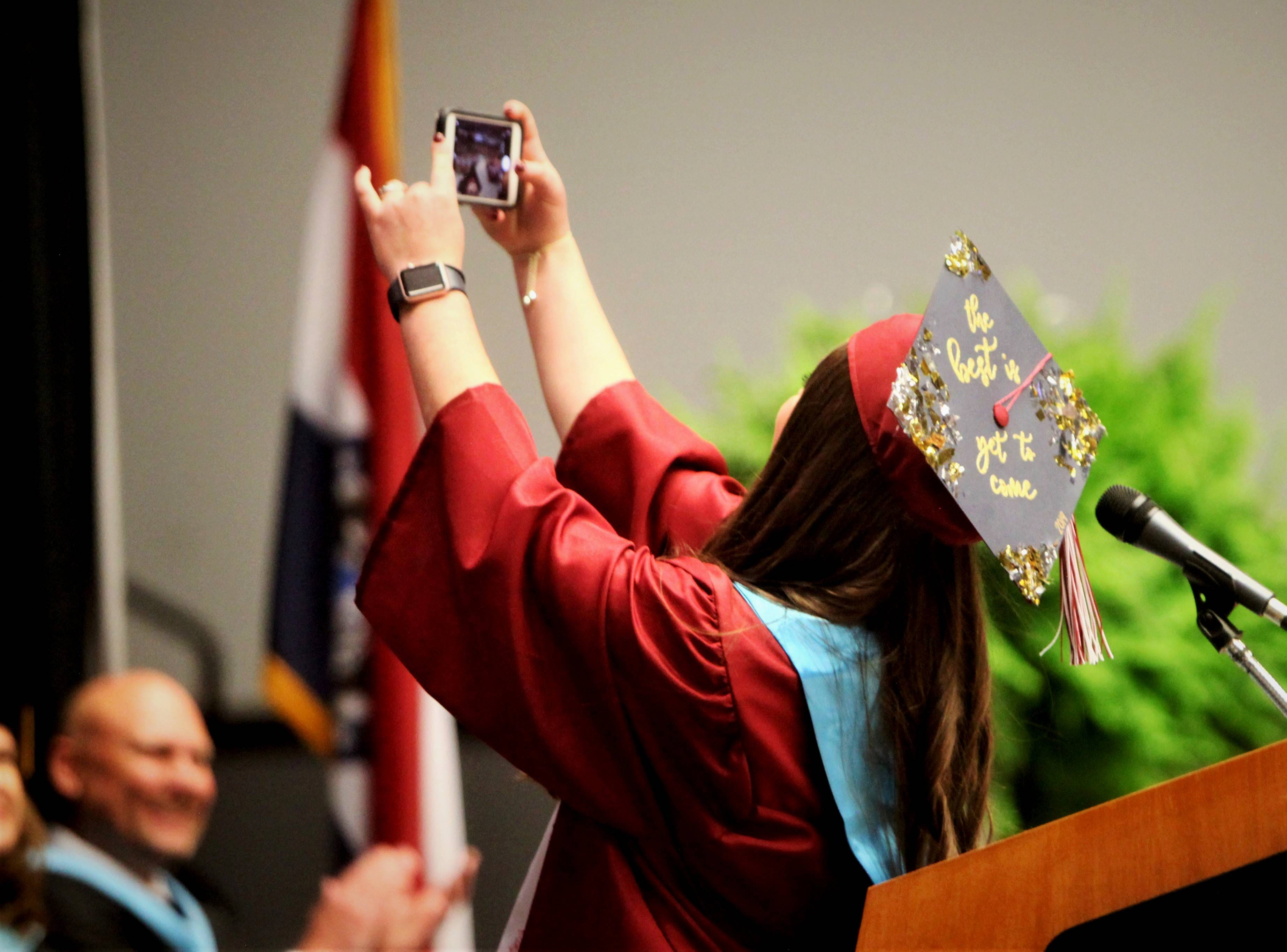 After giving her commencement speach, Sydney Dunavant takes a selfie with Logan-Rogersville High School's graduating class Sunday, May 12, 2019, at O'Reilly Family Event Center.