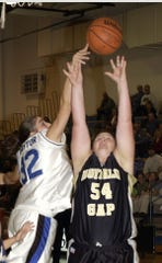 In a file photo from 2003, Fort Defiance's Heather Claytor blocks a shot by Buffalo Gap's Becky Burns. Both women plan to play in this summer's YMCA women's basketball league