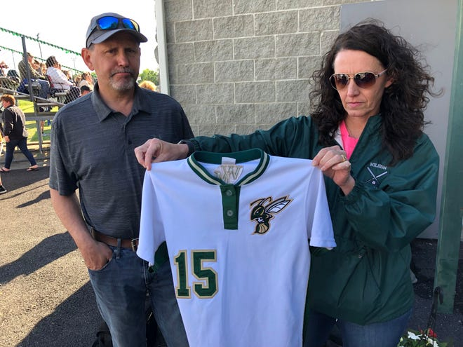 Chris and Dana Craig were given the Wilson Memorial softball jersey of their late daughter, LeAnna, during a ceremony to honor the former Hornet Monday.