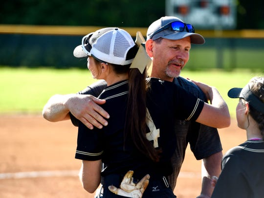 Chris Craig hugs the Buffalo Gap players before Monday's softball game. Craig's daughter, LeAnna, who died in a motorcycle crash last July, was honored before the game. She was a former Wilson Memorial Hornet.