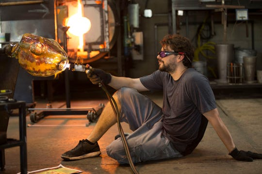 Glass Sculptor Grant Garmezy sculpting some pieces. He will be featured at the 2019 Virginia Hot Glass Festival May 25-26.