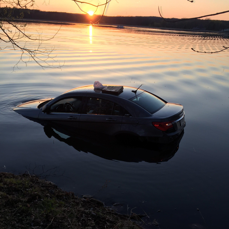 Avon man unhurt after crashing car in Lower Spunk Lake