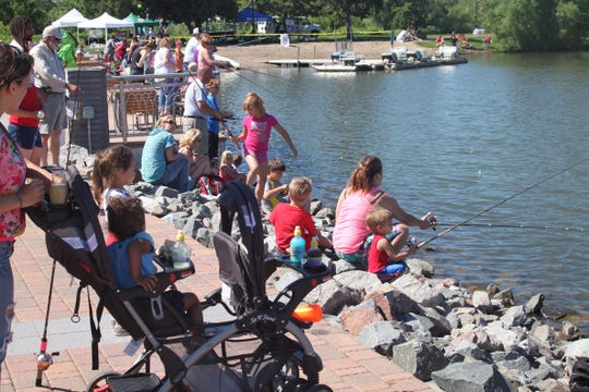 Event-goers enjoy fishing at Lake George. The Summer Kickoff at Lake George has been rescheduled to noon-3 p.m. June 1.