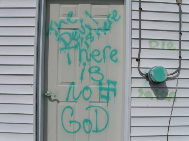 A swastika and anti-Christian language is seen on the door of a Babcock church May 11. Two churches and a vehicle were reported to have been vandalized with the spray paint the evening of May 10.