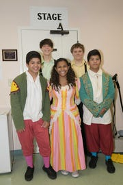 "Aldo, Erianna and Alvin Cruz, in front, with alumni Gary Williams and Michael Todd at Renaissance Charter School of St. Lucie's production of ""Beauty and The Beast"" at the Sunrise Theatre in Fort Pierce."