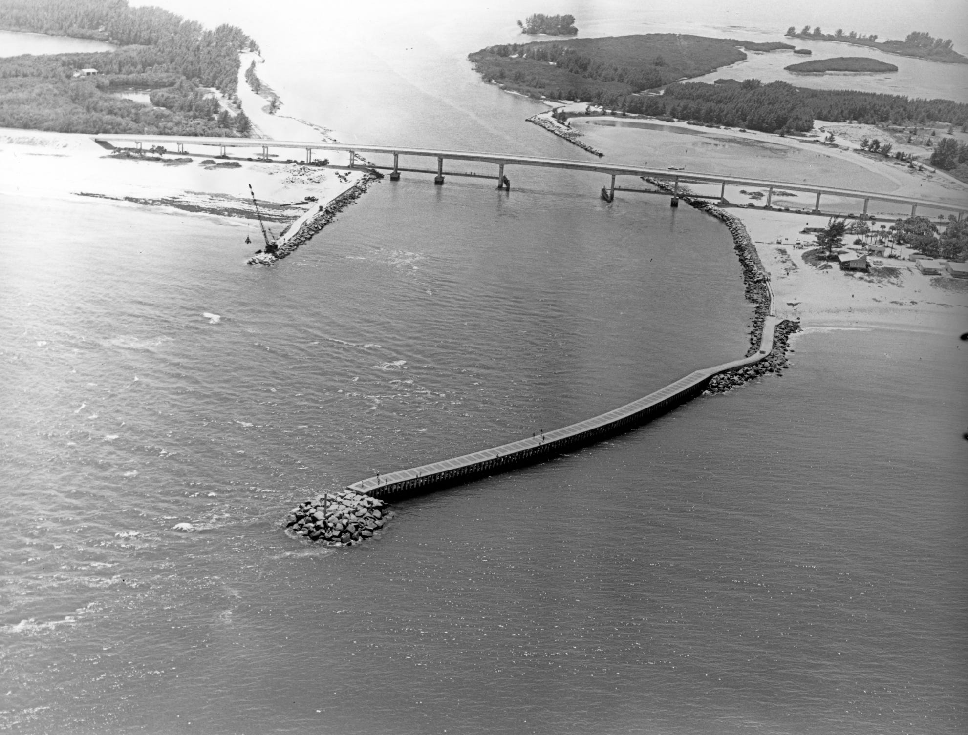 1970 aerial view of the south Jetty extension construction with concrete cap.