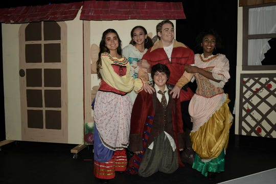 "Lucia Gomez, left, Chloe Johnson and Elise Townsend, right, as the Silly Girls, Liam Suhrie as Gaston and Bernardo Ivens-Ferraz as LeFou at Renaissance Charter School of St. Lucie's production of ""Beauty and The Beast"" at the Sunrise Theatre in Fort Pierce."