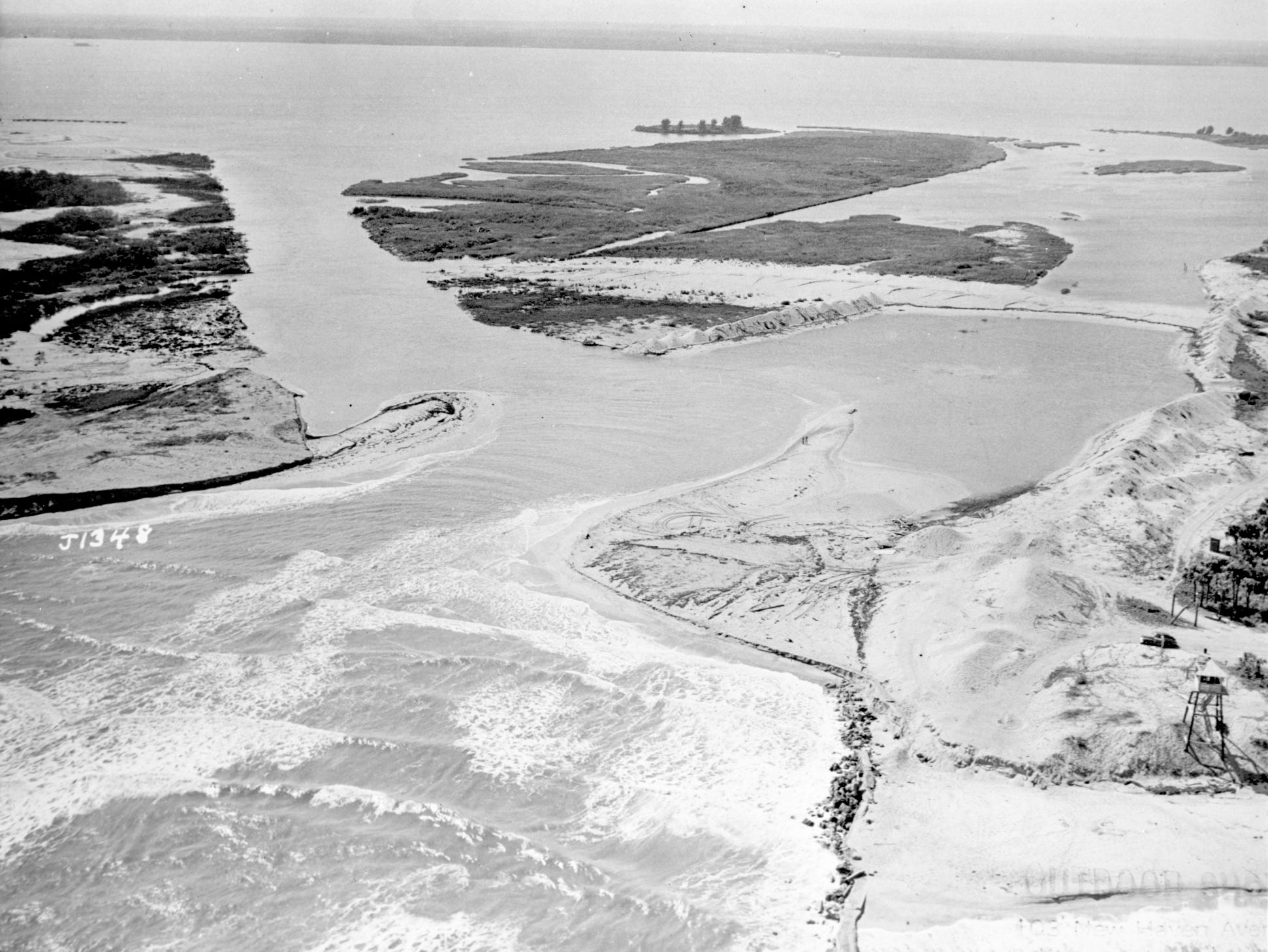 Aerial view of the open Sebastian Inlet in November 1948, showing the WWII spotting tower that was manned by citizen patrols during the war to scan the coast for German U-boats ( lower right hand corner).