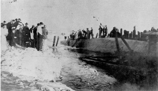 First water flowing through the temporary opening of the Sebastian Inlet in 1918.