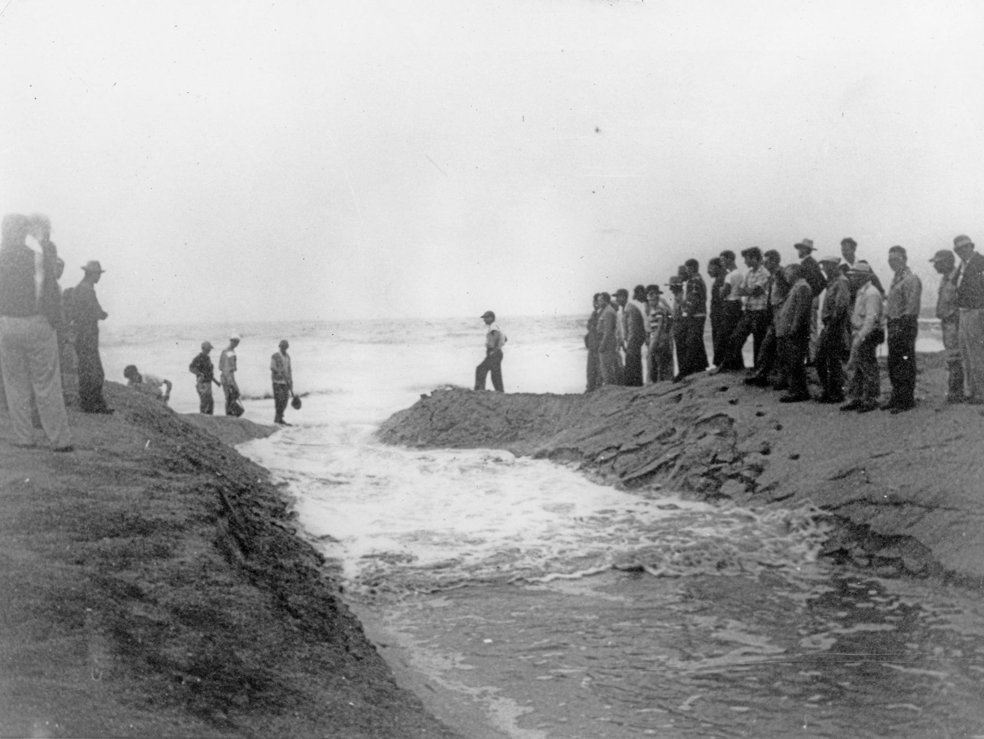 First water flowing through the newly opened Sebastian Inlet in 1948.