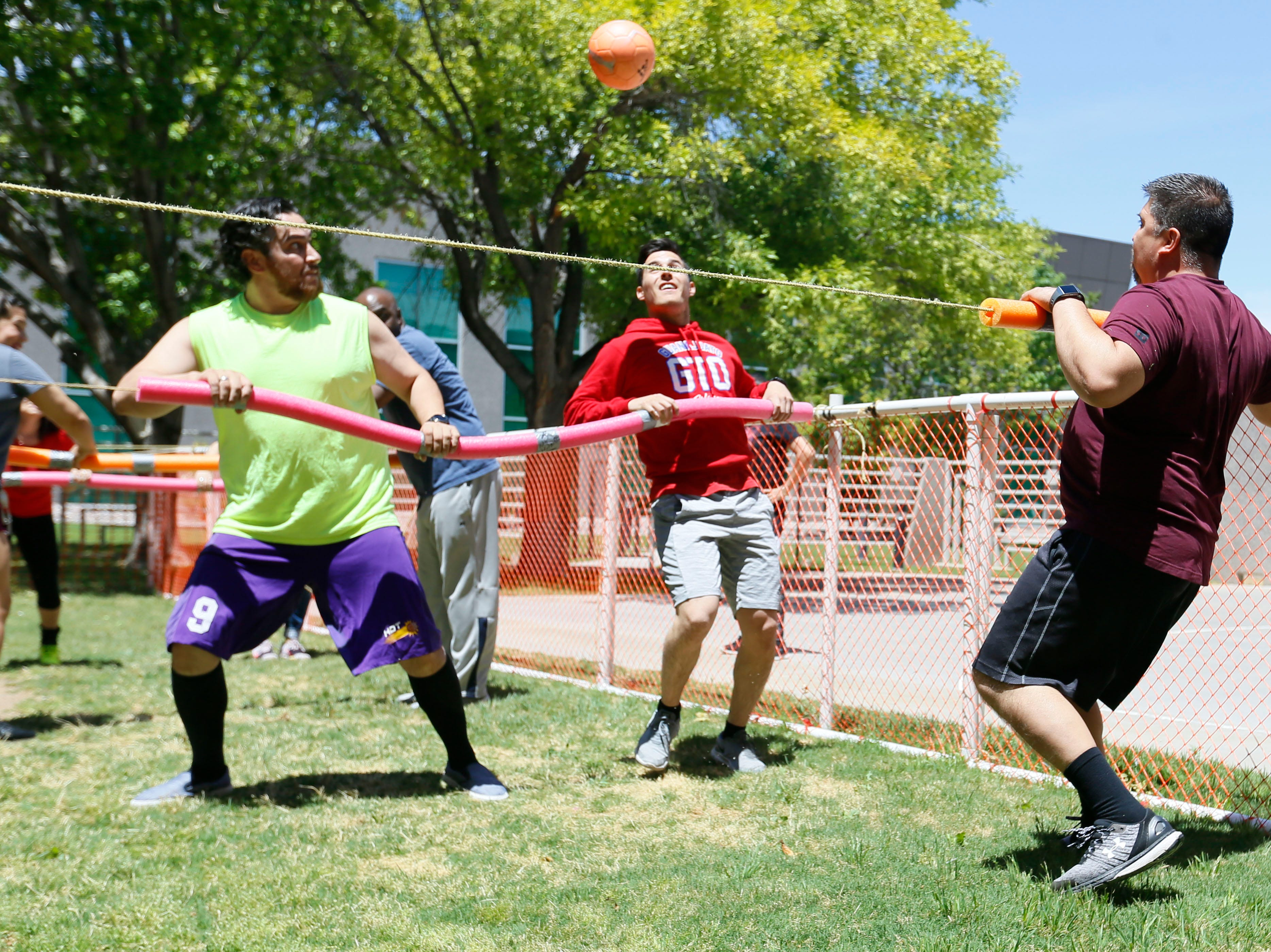 Helen of Troy senior tax accounting Jesus Villarreal, left, and tax staff accountant Roberto Valverde, right, attempt to score a goal against trade management analyst Larry Dominguez during human foosball tournament Monday, May 13, at Helen of Troy. The tournament benefited Junior Achievement of El Paso. Participating associates paid a $10 participation fee per player. Proceeds go towards Junior Achievement's Bowl-A-Thon.