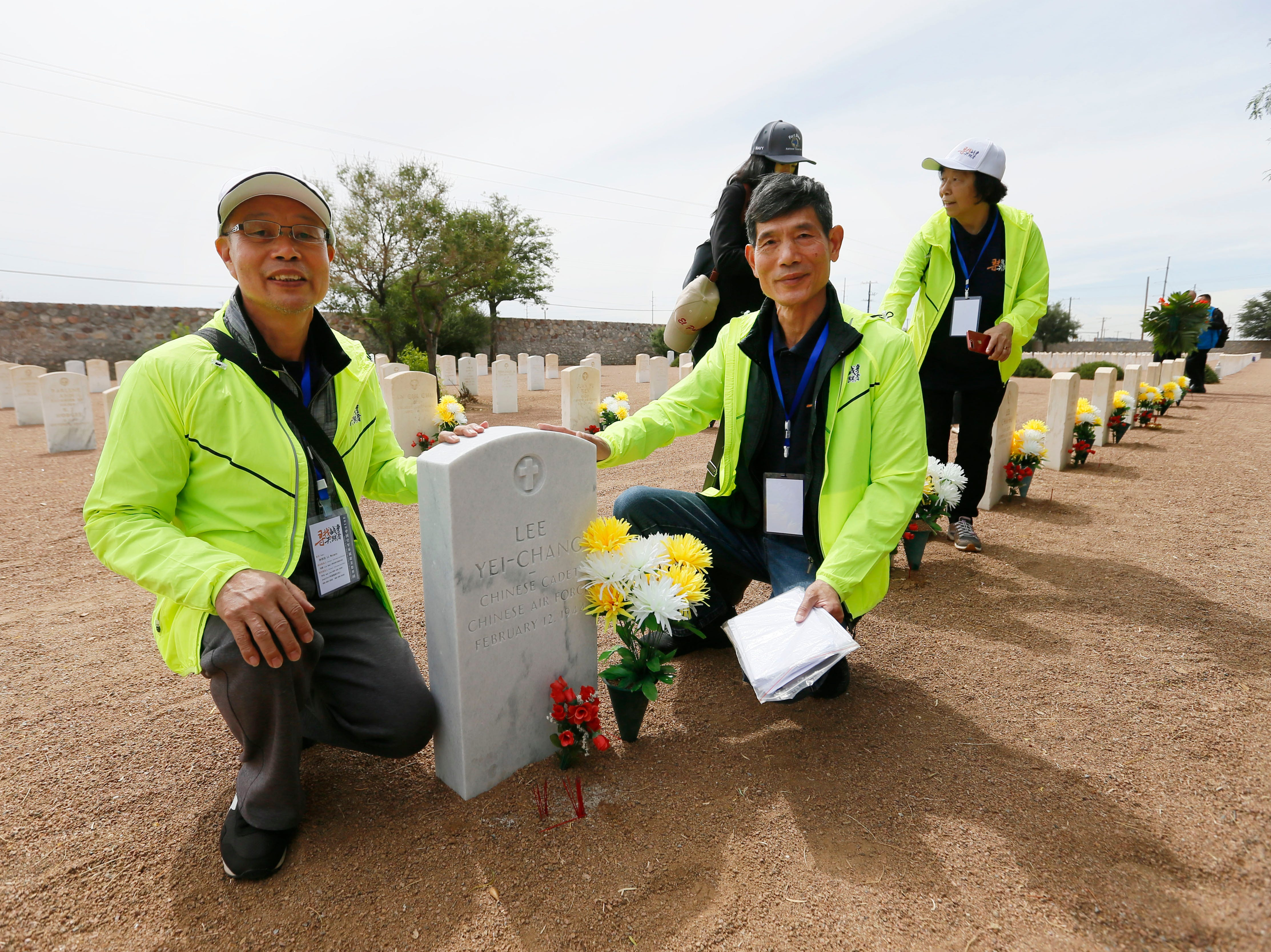 Li Shihua, right, and Li Weimin, left, visit where Li Shihua's great uncle Lee Yei-Chang was buried Monday, May 13, at Fort Bliss National Cemetery. The Hunan LongYue Peace Charity Development Center brought family members to El Paso to pay a special remembrance to their relatives who are amongst the 52 Chinese pilots who died in the U.S. during flight training in World War II.