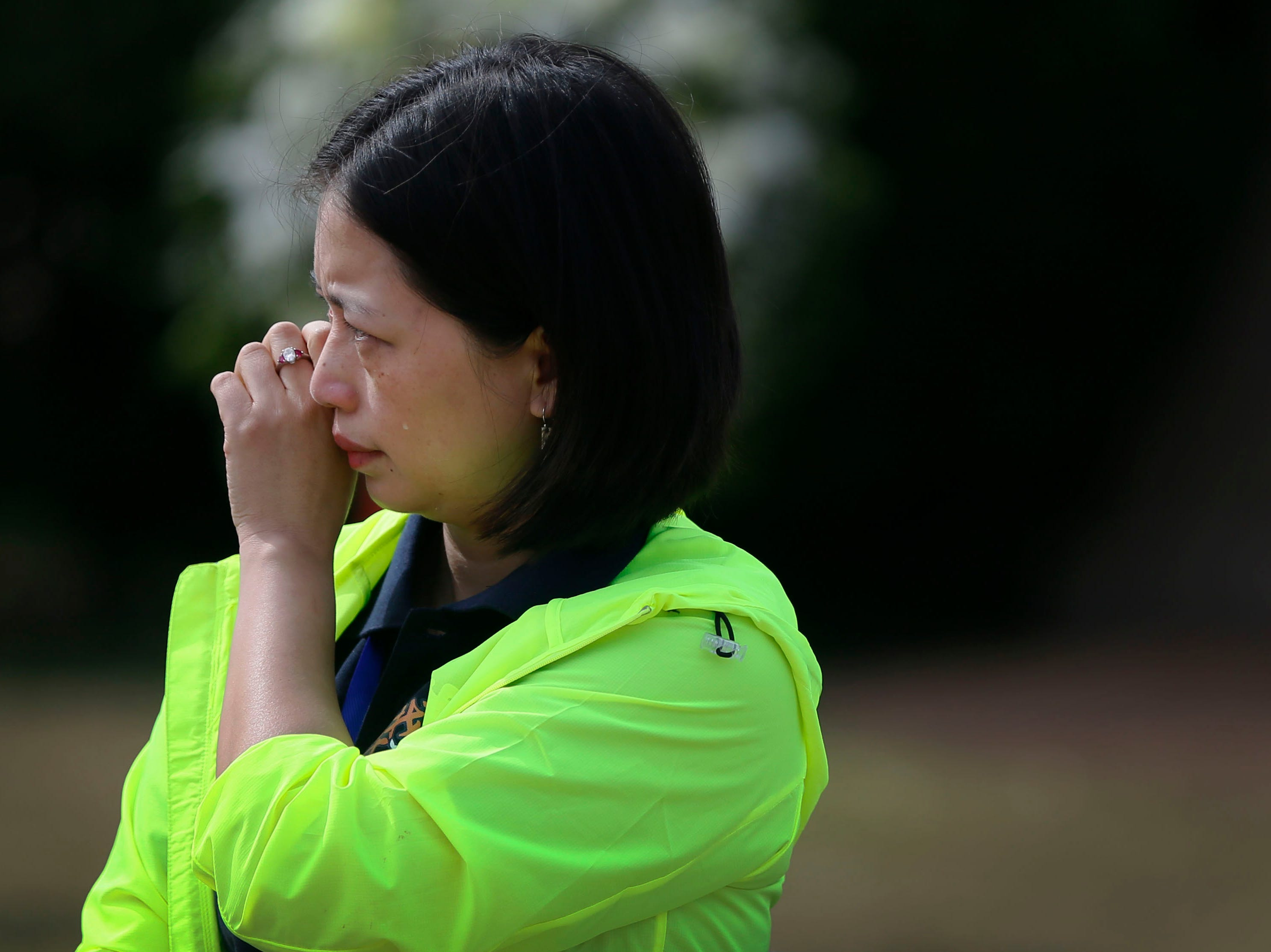 Longyue Charity Foundation member Qun Liu tears up during the ceremony at Fort Bliss National Cemetery Monday, May 13, in El Paso. The Hunan LongYue Peace Charity Development Center brought family members to El Paso to pay a special remembrance to their relatives who are amongst the 52 Chinese pilots who died in the U.S. during flight training in World War II.