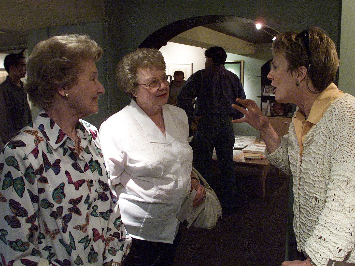 5/18/2000 Jenna Welch, Mary Bowhay and Adair Margo discuss some of the art work that is on display at Margos art gallery.