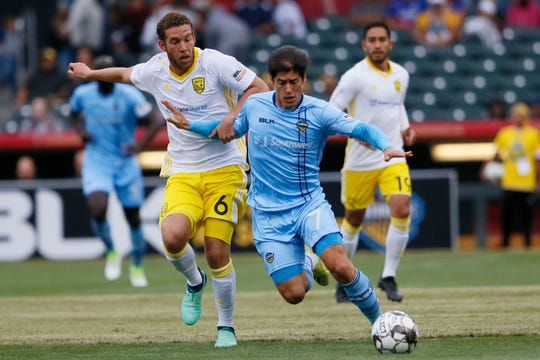 El Paso Locomotives' Calvin Rezende goes against New Mexico United's Toni Soler during the game Sunday, May 12, at Southwest University Park.