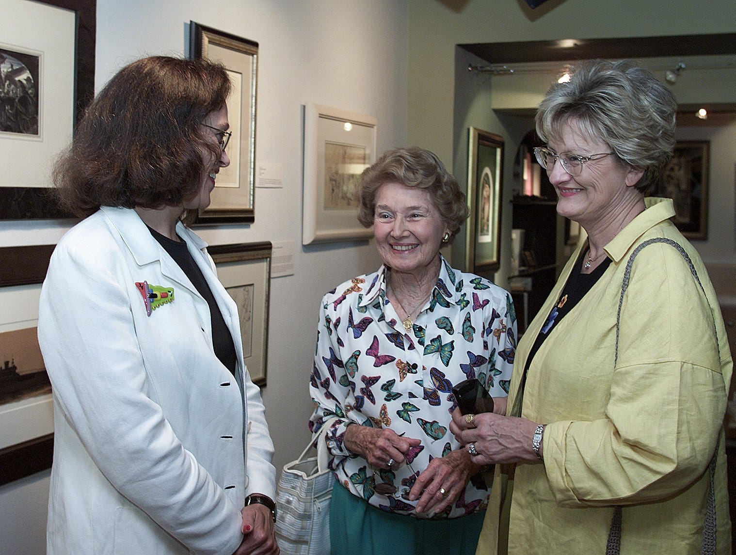 5/18/2000 Regan Gammon, Jenna Welch and Nelda Laney share a moment while on a tour of the Adair Margo Gallery and the art work on display.