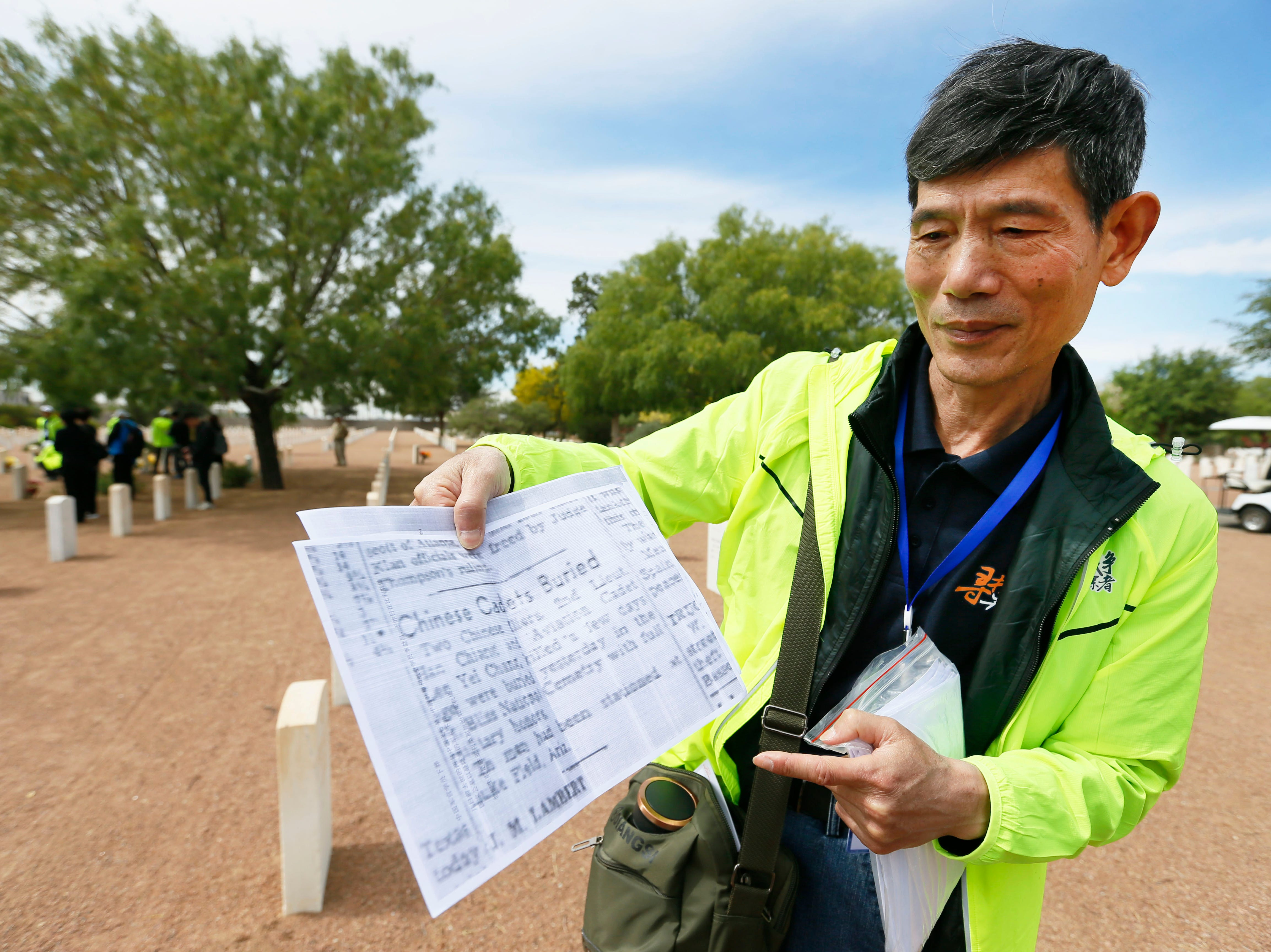 Li Shihua shows an El Paso Herald-Post article written about his great uncle Lee Yei-Chang that he found in archives Monday, May 13, at Fort Bliss National Cemetery. The article was written when Li Shihua's great uncle was buried in El Paso. The Hunan LongYue Peace Charity Development Center brought family members to El Paso to pay a special remembrance to their relatives who are amongst the 52 Chinese pilots who died in the U.S. during flight training in World War II.
