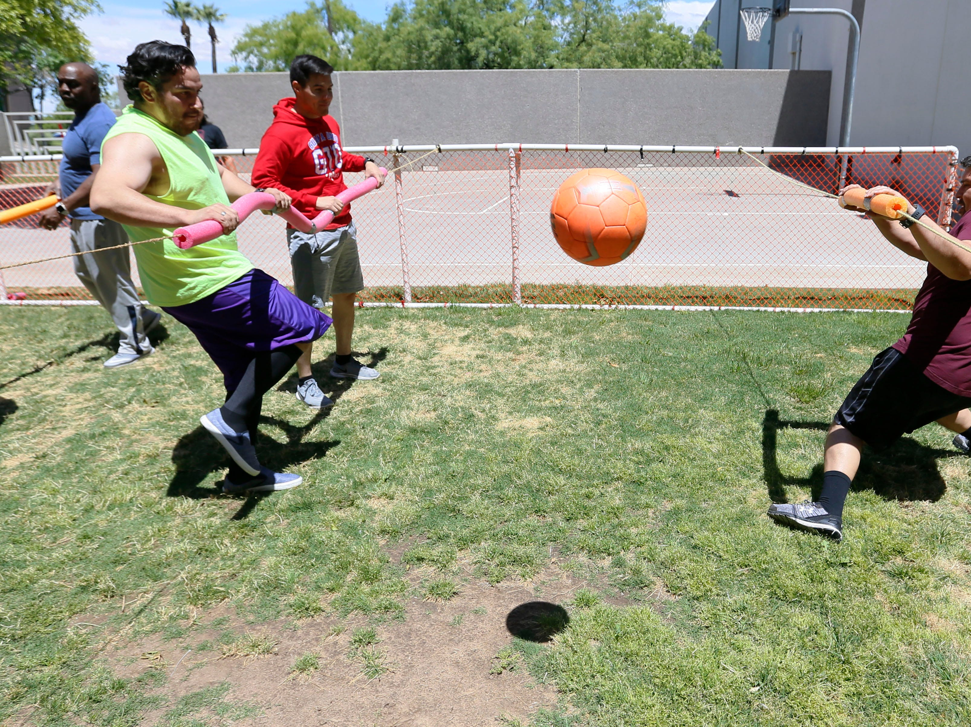 Helen of Troy trade management analyst Larry Dominguez attempts to guard the goal against senior tax accounting Jesus Villarreal, left, and tax staff accountant Roberto Valverde, right, during human foosball tournament Monday, May 13, at Helen of Troy. The tournament benefited Junior Achievement of El Paso. Participating associates paid a $10 participation fee per player. Proceeds go towards Junior Achievement's Bowl-A-Thon.
