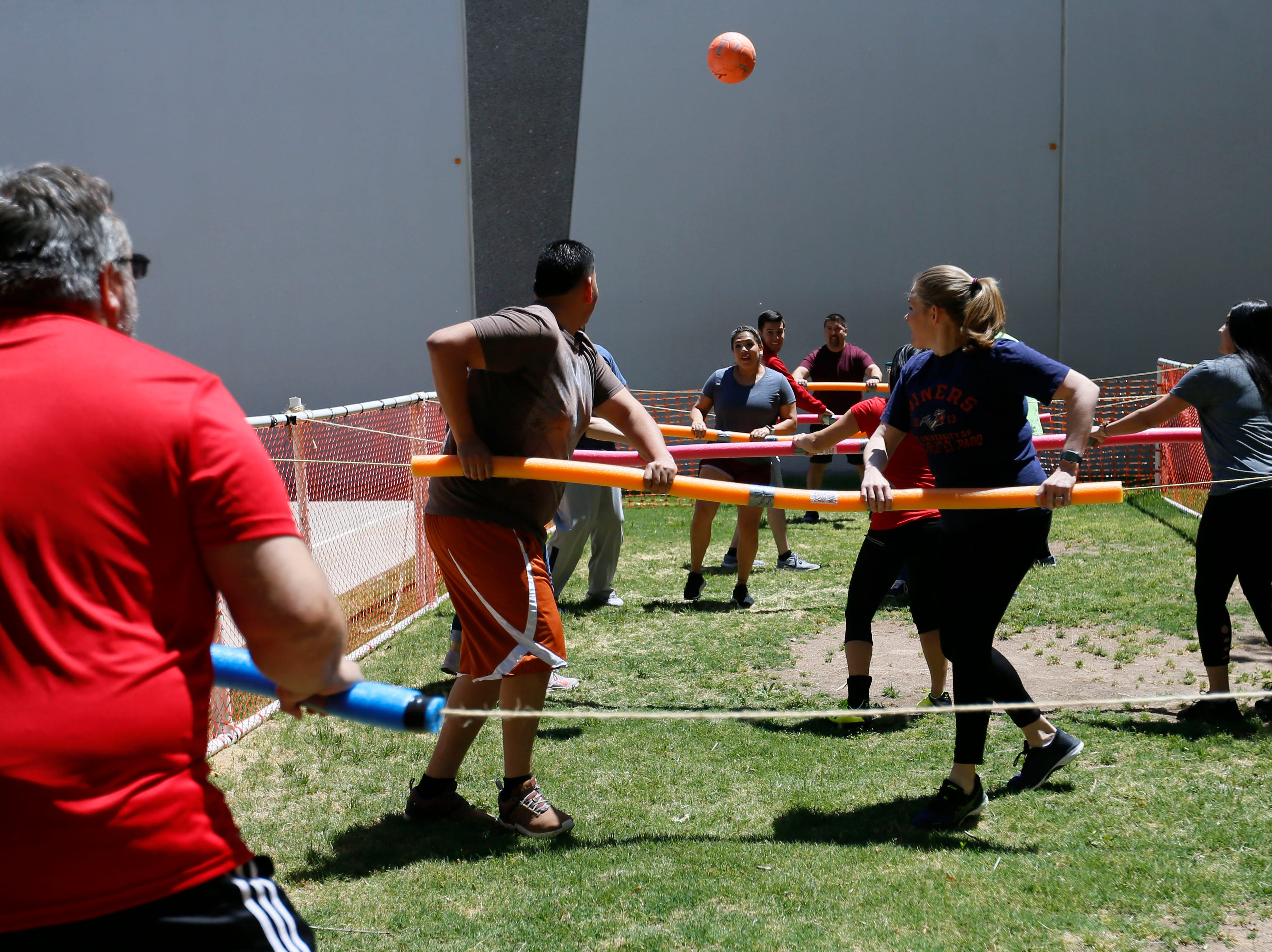 Helen of Troy employees participate in a human foosball tournament Monday, May 13, at Helen of Troy. The tournament benefited Junior Achievement of El Paso. Participating associates paid a $10 participation fee per player. Proceeds go towards Junior Achievement's Bowl-A-Thon.