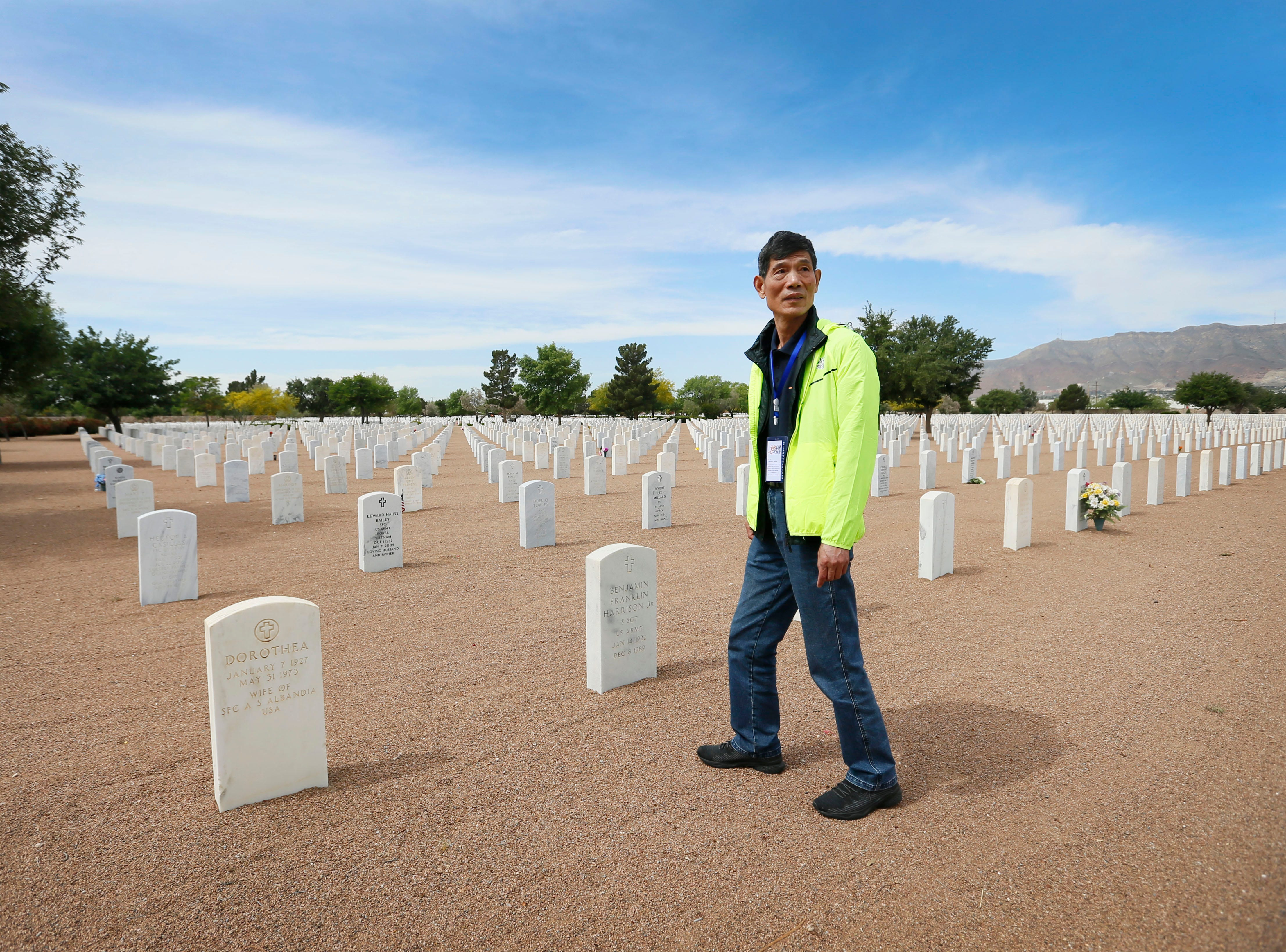 Li Shihua walks towards the area where his great uncle Lee Yei-Chang was buried Monday, May 13, at Fort Bliss National Cemetery. The Hunan LongYue Peace Charity Development Center brought family members to El Paso to pay a special remembrance to their relatives who are amongst the 52 Chinese pilots who died in the U.S. during flight training in World War II.
