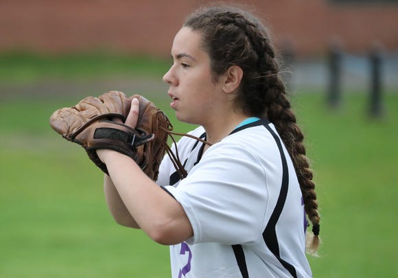 Clarkstown North pitcher Kaitlyn Fudge warms up with her old glove May 10, 2019.