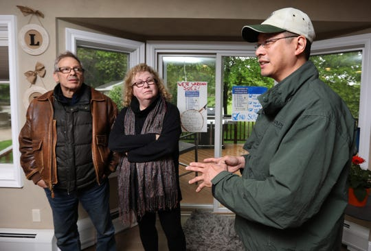 Max and Rivka Estroff and Albert Cruz in Lynne Munroe's Valley Cottage home talking about their opposition to Suez Water's plan to move into Tilcon's old offices in West Nyack near their homes May 13, 2019.