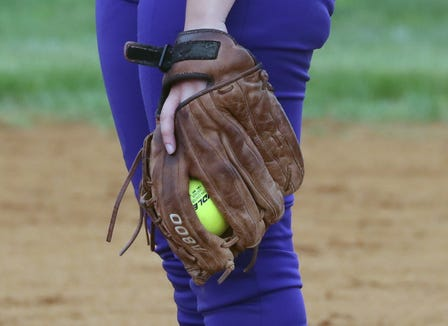 Clarkstown North's Kaitlyn Fudge pitches during a game with Clarkstown South at North May 10, 2019. She has been using the same glove since she was 12.