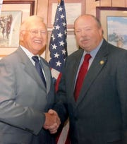 Rockland Sheriff Thomas Goldrick, left, shakes hands with his successor James Kralik