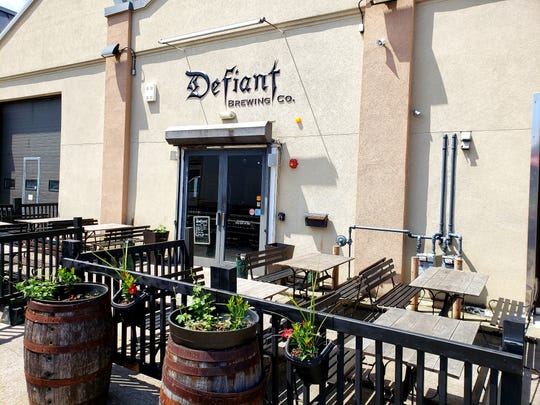 Outdoor area at Defiant Brewing Company is an ideal place to enjoy one of their craft brews and bring your dog.