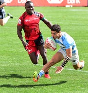 Francisco Ulloa of Argentina on his way to a score as Bush Mwale of Kenya closes in during their pool match on day two of the USA Sevens Rugby tournament in Las Vegas, Nevada on March 2, 2019.  A. Jon Prusmack revived the USA Sevens, moved it to Las Vegas and grew it to one of the most popular tour stops on the international calendar.