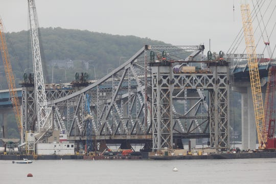 The final remaining section of the Tappan Zee Bridge is being lowered as seen from Tarrytown May 13, 2019. In an operation taking several days, the section is being lowered onto a barge and will be taken away.