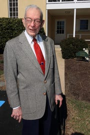 Donn Devine outside the Diocesan Archive at the time of his retirement in March 2016.