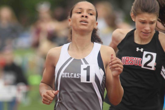 Delcastle's Jalissa Emmens (1) wins the girls 800-meter run during the New Castle County Track and Field Championships on Saturday at Charter of Wilmington.