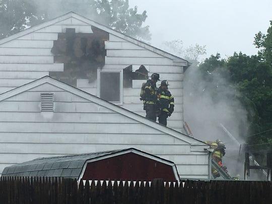 Firefighters battle a house fire near Newark.