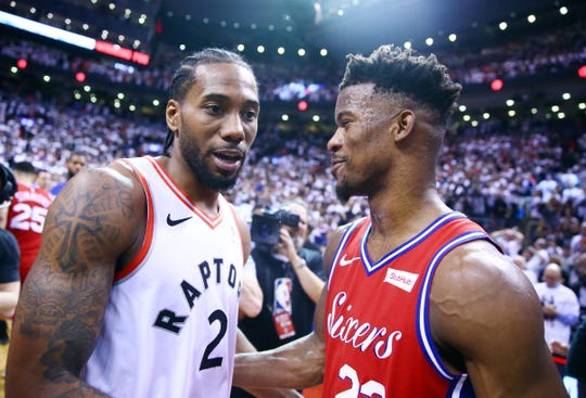 Kawhi Leonard #2 of the Toronto Raptors speaks with Jimmy Butler #23 of the Philadelphia 76ers after sinking a buzzer beater to win Game Seven of the second round of the 2019 NBA Playoffs at Scotiabank Arena on May 12, 2019 in Toronto, Canada.