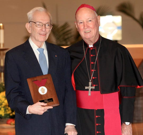 Donn Devine receives the Order of Merit from Bishop Malooly during the Diocesan Awards at St. Joseph Church in Middletown on Sunday, Oct. 2, 2016.