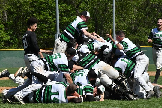 Wilmington University celebrates its CACC baseball title.