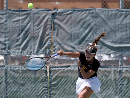 Midwestern State's Ashley Ramirez serves in a match against St. Mary's Ashley Penshorn Monday, May 13, 2019, in the NCAA DII South Central Regional at the MSU Tennis Center.
