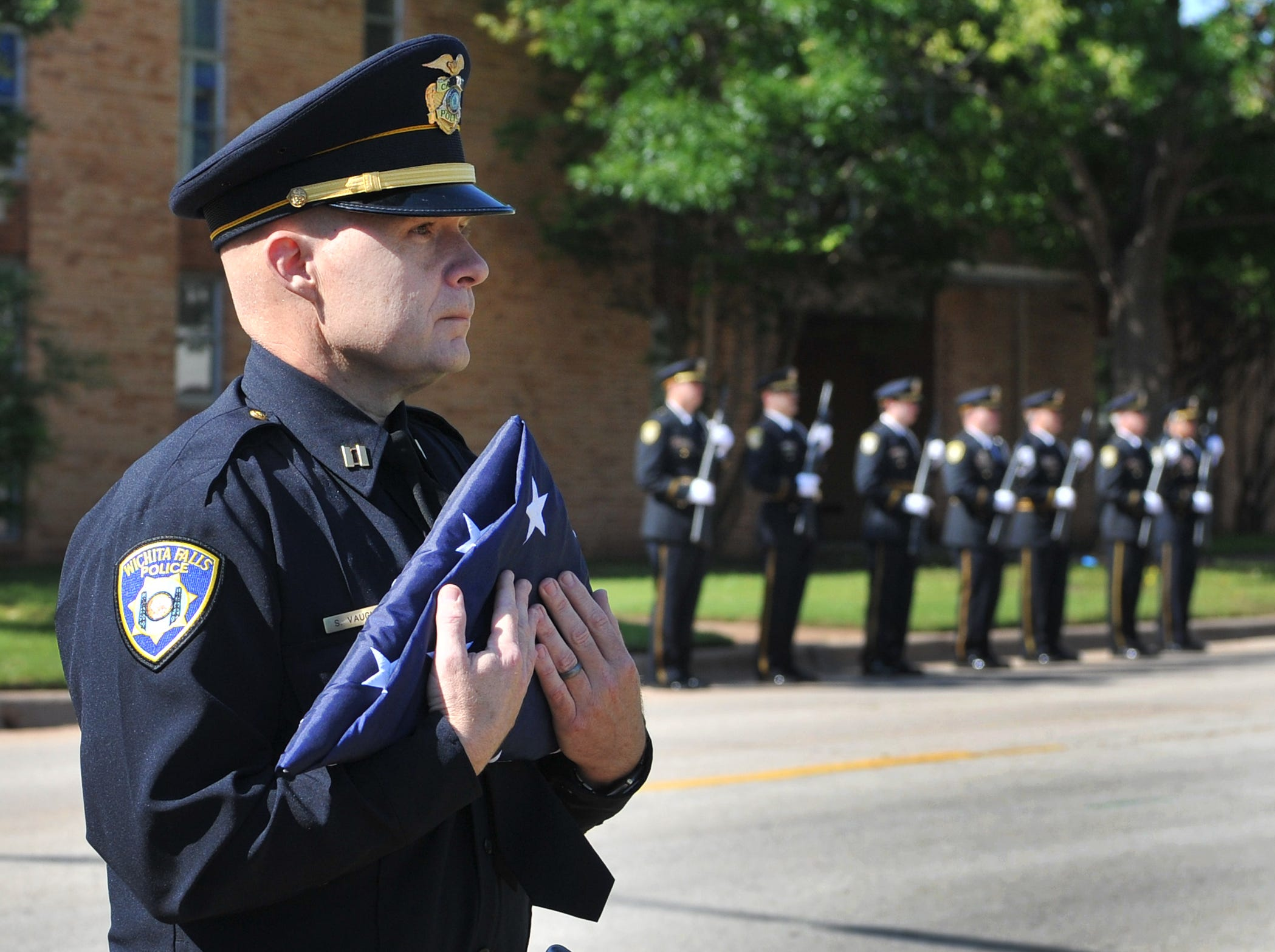 Wichita Falls police captain, Scott Vaughn stands ready to pay his respects during the WFPD annual memorial service held to honor officers that have fallen during their duty to serve.
