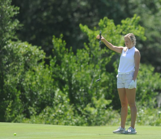 Jacksboro's Carli Smith lins up a putt during Monday's opening round at the Class 3A Tournament at Grey Rock Golf Course