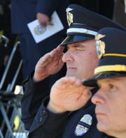 Wichita Falls police officer Timothy Johnson paid his respects during the department's annual memorial service held in front of the police department, Monday morning.